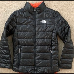 The North Face Black women's puffer coat.